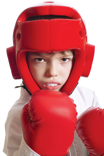 child with sparring gloves helmet mouthguard